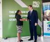Proman Chief Executive David Cassidy and Habitat Trinidad National Manager Jennifer Massiah shake hands